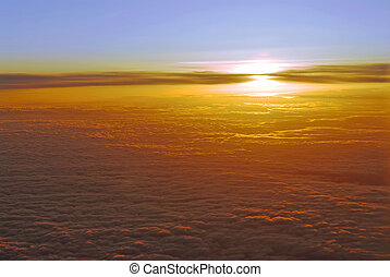 Above the clouds - Spectacular view of a sunset above the...