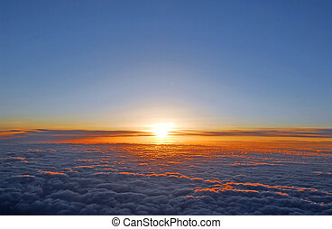 Above the clouds - Spectacular view of a sunset above the ...