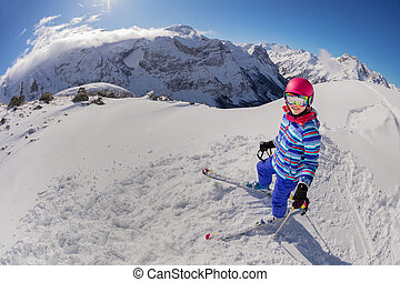 Above view of a girl with ski on mountain slope