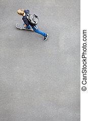 above view of a teen boy skateboarding