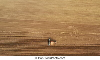 Above view of agriculture machinery on spring field, working...