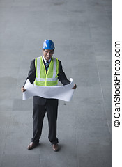Above view of an Indian Architect or industrial engineer.