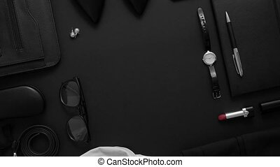 Above view of assortment of essential businness woman items. Elegant clothes, watch, lipstick, smartphone, glasses. Top view, flat lay.