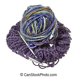 above view of ball of yarn on knitted snood scarf