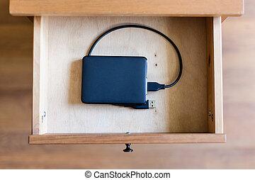 external hard drive in open drawer