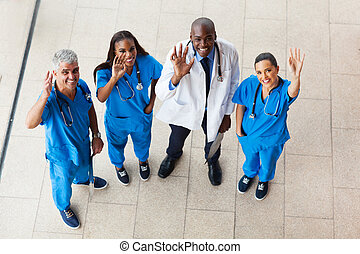 above view of medical doctors waving