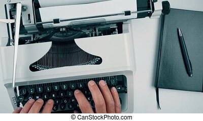 above view of person writing words CHAPTER 1 on old typewriter