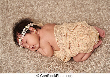 Above view of small sleeping newborn baby