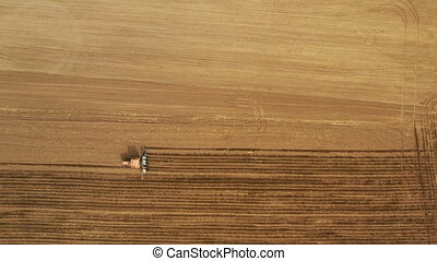 Above view of working traktor on spring field, agriculture ...