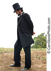 Abraham Lincoln Alive - Abraham Lincoln standing outside at...