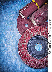 Abrasive flap wheel grinding disc sandpaper rolls on metallic ba