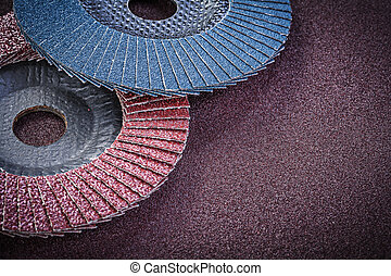 Abrasive flap wheels on sandpaper sheet top view