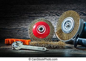 abrasive wire tools set on vintage wood background