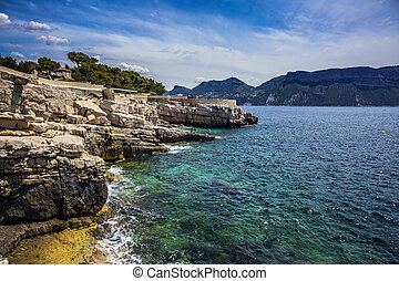 Abrupt stony coast and turquoise sea surface. Famous...