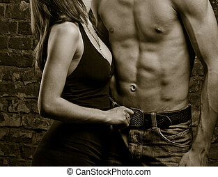 Abs exposed - Young heterosexual couple, moments of intimacy