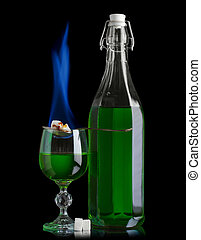 Absinthe bottle and glass with lump sugar burning