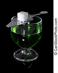 Absinthe - Glass with absinthe liqueur and a spoon with ...