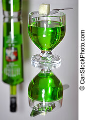 Absinthe reflection - Glass of absinthe liqueur with a spoon...