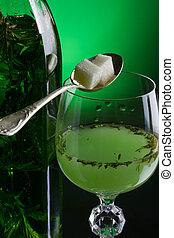 Absinthe with sugar close-up
