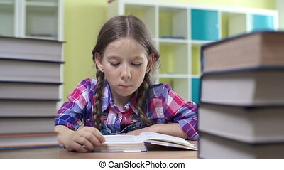 Absorbed in Reading - Close up of school girl framed with...