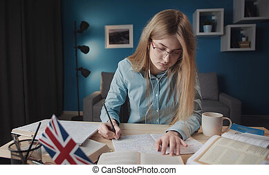 Absorbed woman learning English