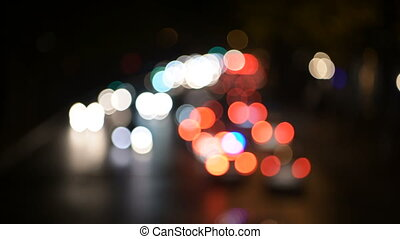 abstact blur bokeh of Evening traffic jam on road in city. -...