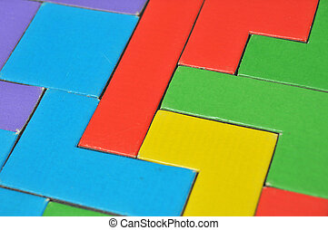 Colorful puzzle pieces put together. this makes a good background. This toy is made out of cardboard.