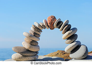 Abstract Arch - Red stone in the center arch of pebbles