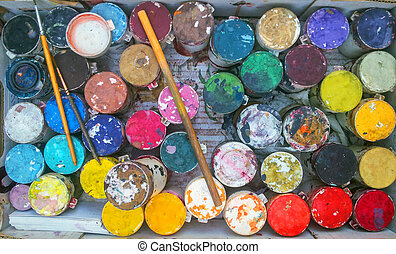 Abstract art background with dirty paintbrushes and watercolors
