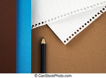 black pencil on colored paper