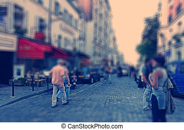 Abstract background. Boulevard Montmartre in Paris - radial zoom blur effect defocusing filter applied, with vintage instagram look.