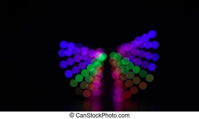 Abstract background colorful blurred bokeh of light moving around. Slow motion