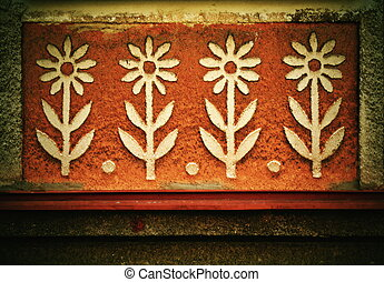 flowers on the plaster of the house