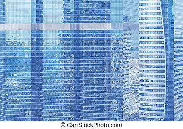 Abstract background from blue glasses window, high modern business building in city. Picture for add text message. Backdrop for design art work.