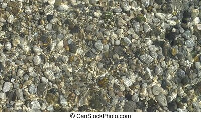 abstract background from light refraction of water and pebble on bottom