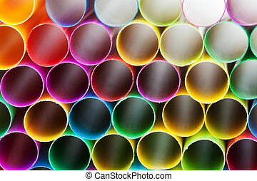 pied plastic drinking straws close up - abstract background...