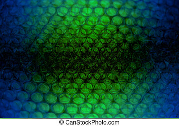 abstract background from plastic wrapper with blue, black ,yellow and white light