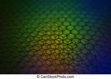 abstract background from plastic wrapper with colorful dark light