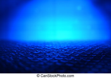 abstract background from plastic wrapper with dark blue and white light