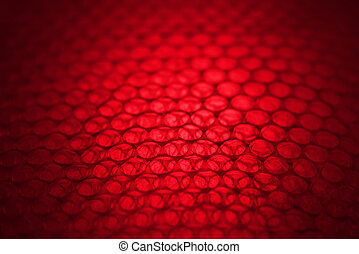 abstract background from plastic wrapper with dark red and white light