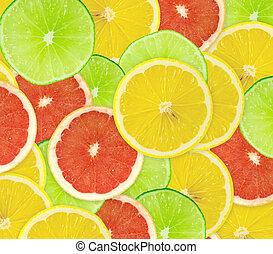 Abstract background of citrus slices. Closeup. Studio photography.