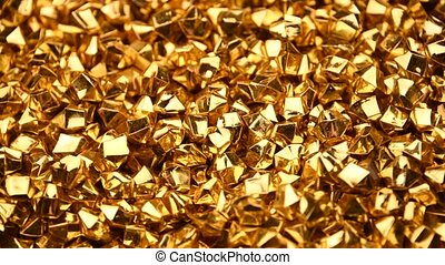 Abstract background of colorful bright golden nuggets spin and flicker, 4K