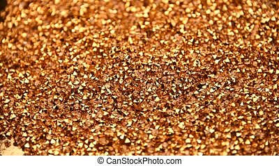 Abstract background of golden rhinestones spinning - ...