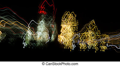 Abstract background of light bulbs at night in motion