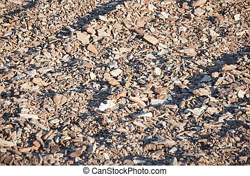 Abstract background of pebbles on a beach with plenty of copy space