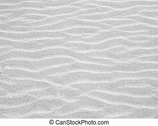 Abstract background of sand ripples at the beach