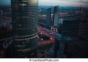 Abstract background of skyscrapers at night in Moscow. Panorama the evening city