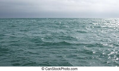 Abstract background of waves on the sea against a cloudy sky...