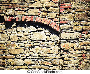 stone wall with brick arch