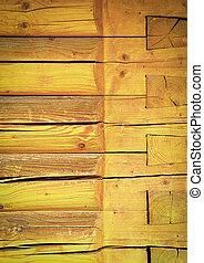 Yellow wall of wooden beams